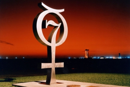 <p><strong>Figure 1.3</strong> In 1964, the logo for Project Mercury was created as a metal commemorative monument, standing near Launch Complex 14 at Cape Canaveral. Source: NASA</p>