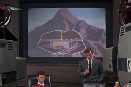 <p><strong>Figure 3.2</strong> At the press conference that follows the activation of Colossus, Forbin explains where the computer system resides deep within a mountain.</p>