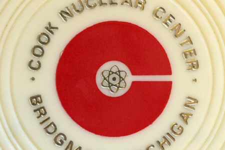 <p><strong>Figure 3.6</strong> The Cook Nuclear Plant logo, as it appeared on promotional drink coasters available from the visitor's center. Source: Roger Strunk</p>