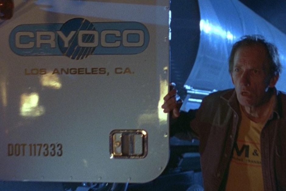 <p><strong>Figure 2.1</strong> When the Cryoco truck driver exits the vehicle to view the helicopter wreck, we see the company logo and location on the door.</p>