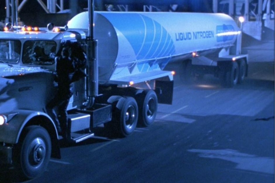 <p><strong>Figure 2.3</strong> The forward end of the tanker trailer is wrapped by a large blue stripe, that is broken into gradated lines.</p>