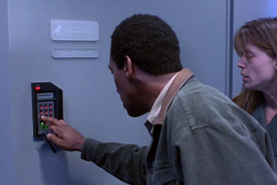 <p><strong>Figure 5.1</strong> As they access the Special Projects Division lab, a plastic door sign bears the 1-color white signature in a vertical lockup.</p>