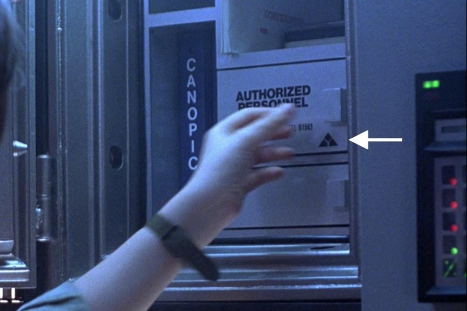 <p><strong>Figure 5.4</strong> A 1-color instance of the mark can be seen on the key safe for the vault, as John Connor opens it.</p>