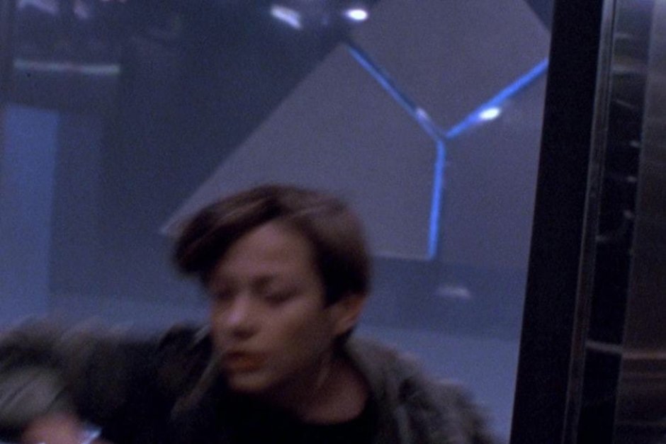 <p><strong>Figure 5.7</strong> As John Connor rounds the corner, we get a slightly clearer view of the mark, as it is backlit with blue light.</p>