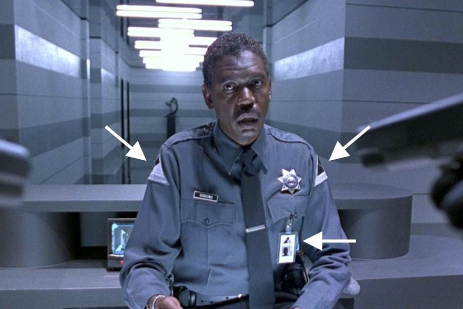 <p><strong>Figure 6.4</strong> Cyberdyne Systems security personnel wear uniforms with shoulder patch identification, that bears the company mark. They also carry employee identification cards.</p>