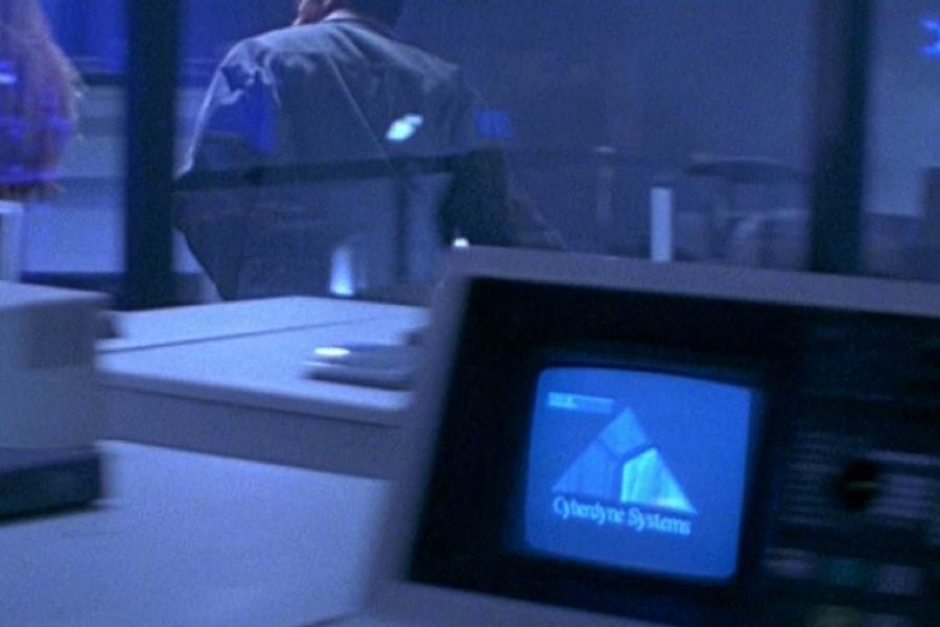 <p><strong>Figure 7.5</strong> As Sarah Connor and Miles Dyson carry items to a pile in the lab, they pass equipment with a screen on it, that features the dimensional, textured Screen-Use Signature A. </p>