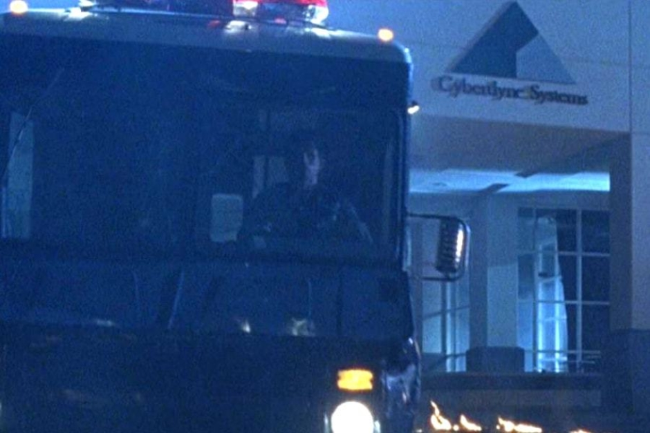 <p><strong>Figure 4.3</strong> A closer look at the front entrance sign can be seen as the Connors and Terminator make their escape from the building.</p>