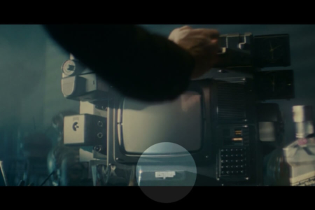 <p><strong>Figure 1.3</strong> As Deckard inserts the photo into his home Esper terminal, the Esper logotype is seen below the monitor (highlighted).</p>