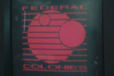 <p><strong>Figure 4.2</strong> Detailed look at the Federal Colonies logo as it appears on wall display monitors.</p>