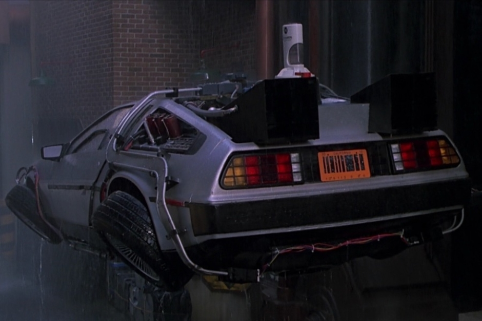 <p><strong>Figure 2.1</strong> In the year 2015, as the hovering time machine comes to a rest in an alley, we see the Mr. Fusion protruding from the car's engine area.</p>