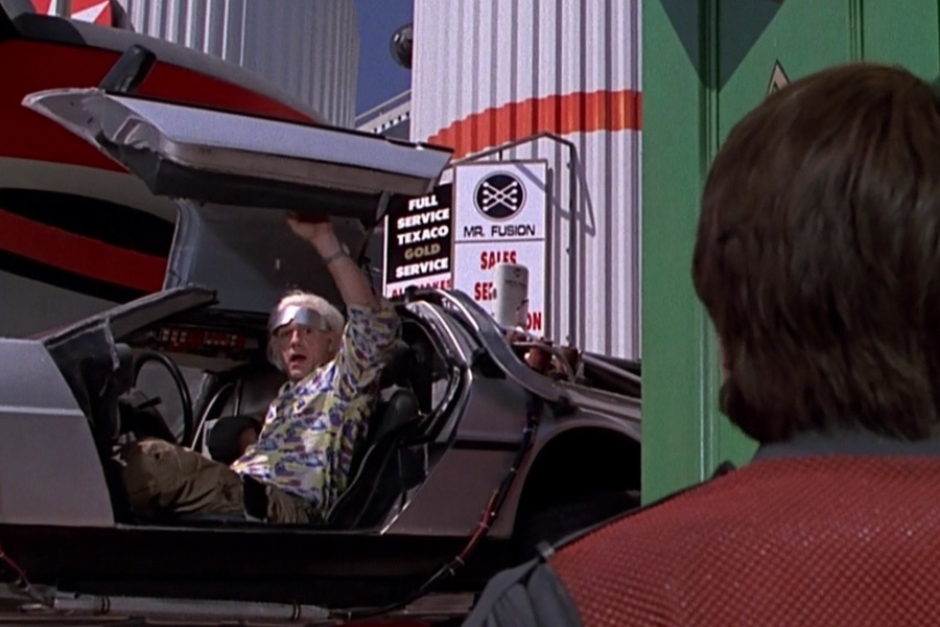 <p><strong>Figure 2.4</strong> When Doc swoops in to pick Marty up from the town square, we see the Mr. Fusion logo in the background, on the service station signage.</p>
