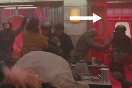 <p><strong>Figure 1.1</strong> The Mars Burger is across the street from The Last Resort, seen through the front door during a fight scene there.</p>