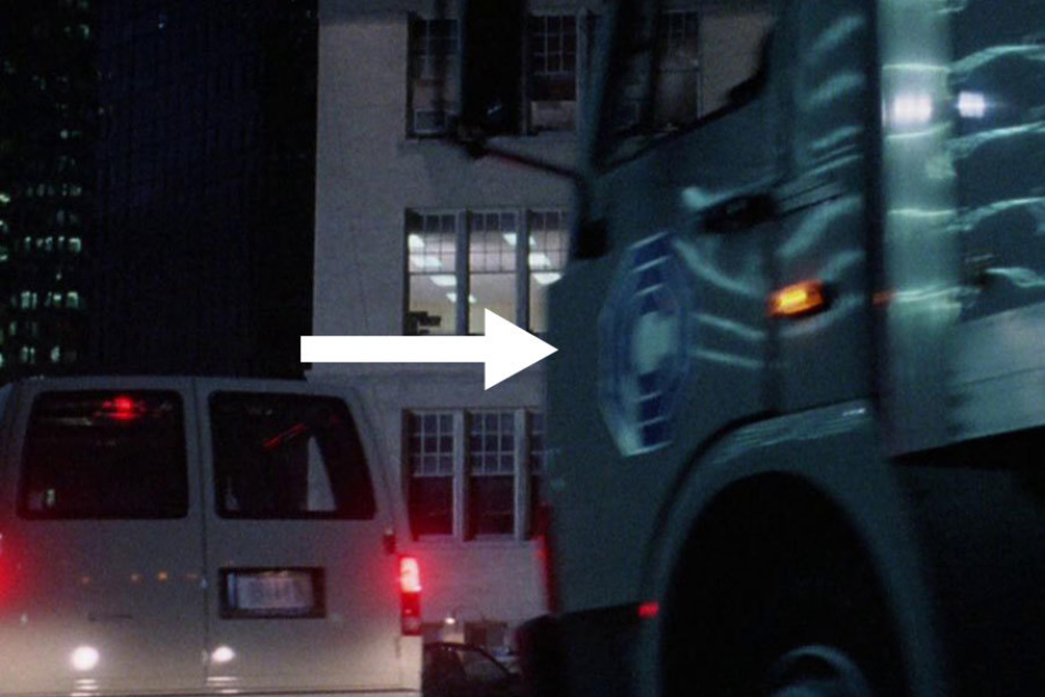 <p><strong>Figure 3.7</strong> In the scene where RoboCop arrives at the police station, we see the OCP logo on the sides of vans and a truck.</p>