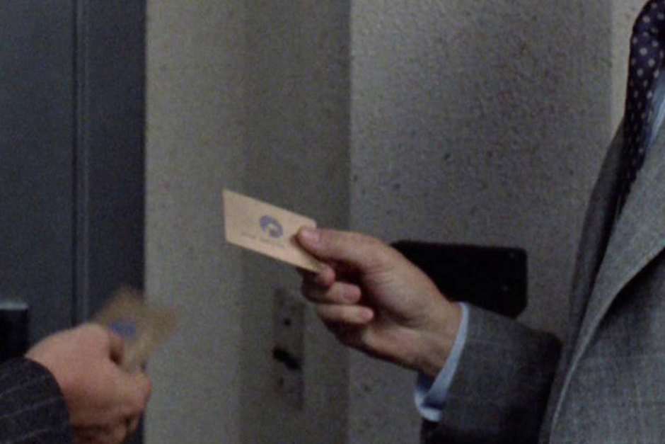 <p><strong>Figure 3.9</strong> Bob Morton and a colleague share a moment in front of the executive restrooms, where we get a glimpse of their gold OCP pass cards.</p>