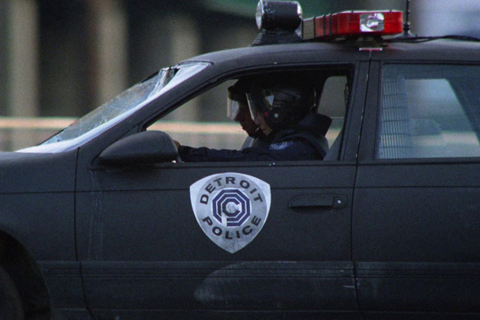 <p><strong>Figure 5.2</strong> A nearly straight on view of the OCP Detroit Police shield, as it appeared on the side of a police car.</p>