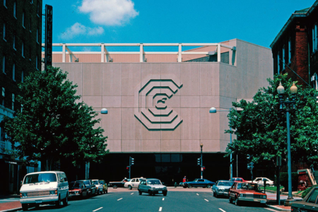 <p><strong>Figure 1.6</strong> The logo for the Washington Convention Center created in stone and mounted to its exterior facade. The octagonal building was imploded in 2004. Source: <em>Lance Wyman: The Monograph</em></p>