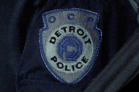 "<p><strong>Figure 4.2</strong> The OCP Detroit Police shield used as a uniform patch, modified in form to accommodate ""OCP"" above the shield's logo/type lockup.</p>"