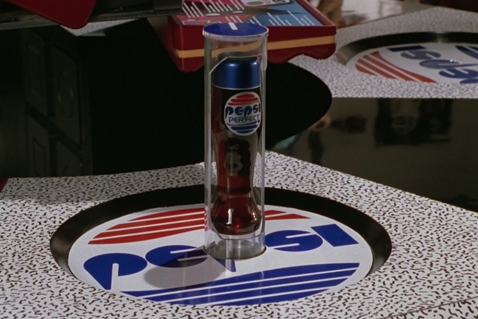 <p><strong>Figure 2.2</strong> When Marty orders a Pepsi, a bottle of Pepsi Perfect is dispensed via a tube that spirals up from below the P in the Pepsi logo.</p>