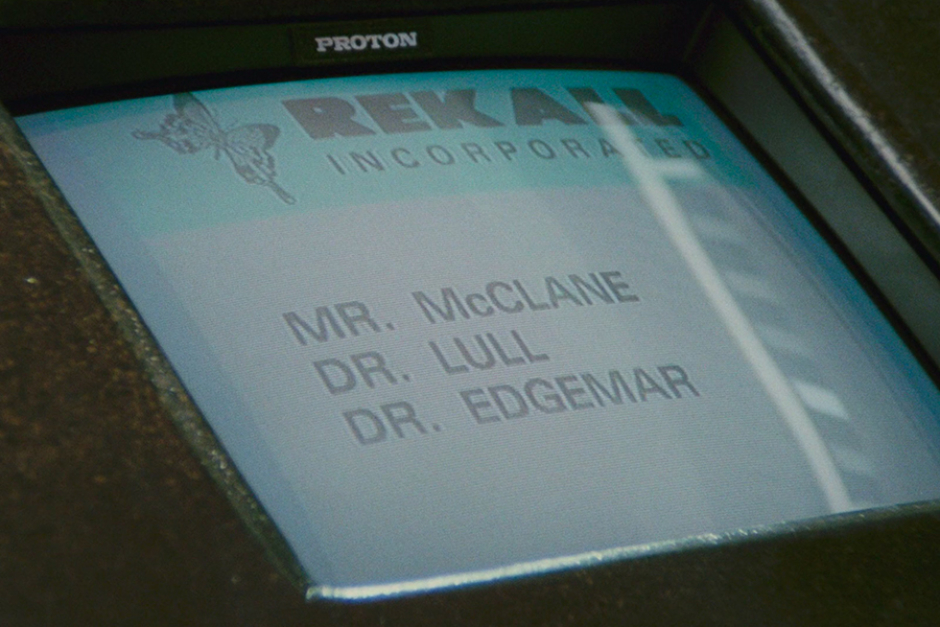 <p><strong>Figure 2.3</strong> The Rekall Incorporated logo on an info console in the lobby, the only time it is seen in the film.</p>