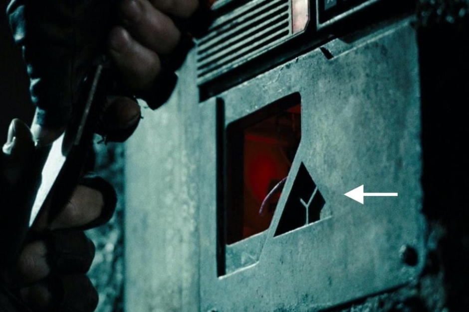 <p><strong>Figure 4.3</strong> Later, when John Connor infiltrates Skynet Central, we get an even closer look at the cast metal Skynet mark. Source: <em>Terminator: Salvation</em></p>