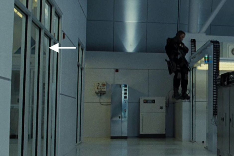 <p><strong>Figure 4.6</strong> As John Connor rappels into the Skynet facility, a large Skynet mark can be seen through the window to an the adjacent room. Source: <em>Terminator: Salvation</em></p>