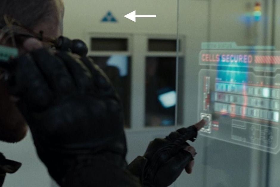 <p><strong>Figure 4.7</strong> As John Connor searches for Kyle Reese, we see instances of the Skynet mark in blue, on the top of cell doors. Source: <em>Terminator: Salvation</em></p>