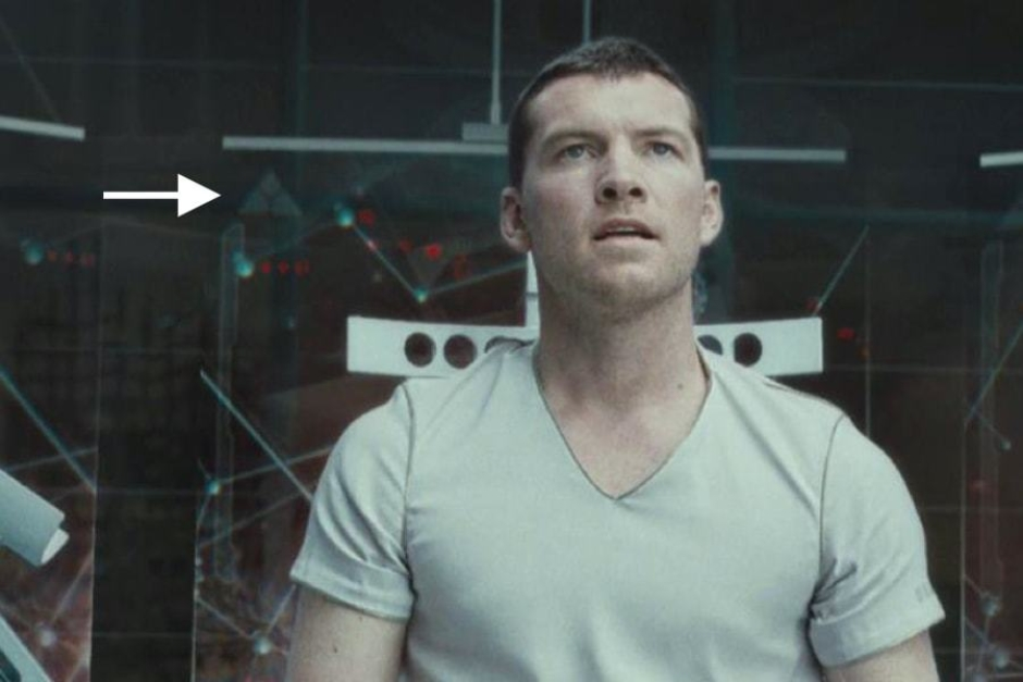 <p><strong>Figure 5.4</strong> White instances of the mark also appear on display screens in the background, as Marcus converses with Skynet's mainframe. Source: <em>Terminator: Salvation</em></p>