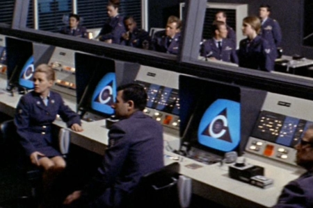 <p><strong>Figure 6.5</strong> The superintelligent artificial intelligence Colossus stating its intent to enforce peace with nuclear force. Its face to the world, is the logo it was given by its human creators. Source: <em>Colossus: The Forbin Project</em></p>