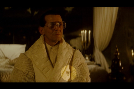 <p><strong>Figure 2.2</strong> When Tyrell is confronted by Roy Batty, the robe he wears carries a monogram owl mark — the only instance of the what is considered the Tyrell logo, that appeared in the film.</p>