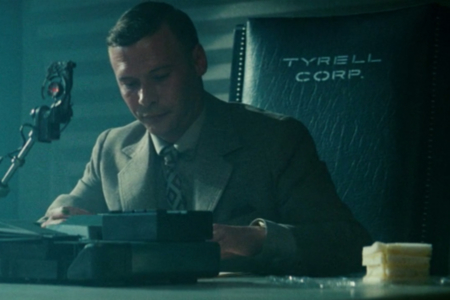 "<p><strong>Figure 3.1</strong> In the scene where Holden interrogates Leon, we see ""TYRELL CORP."" stenciled on chair backs.</p>"