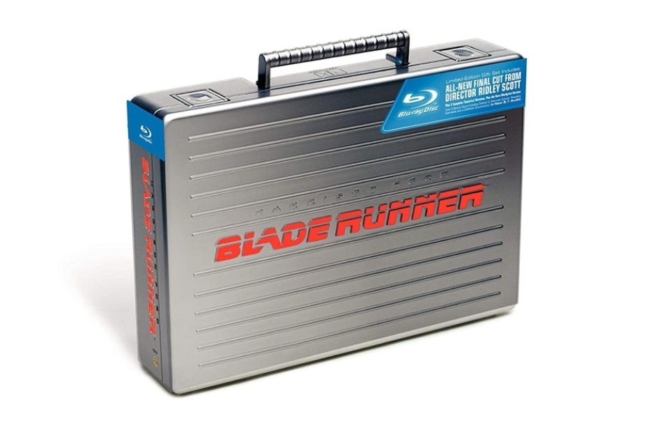 <p><strong>Figure 3.1</strong> The Voight-Kampff logo and logotype appeared in a stacked lockup, embossed above the handle on a metallic briefcase containing the 5-Disc Collector's Edition of <em>Blade Runner</em> (2007). Source: Amazon</p>